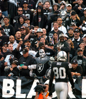 OAKLAND, CA - OCTOBER 17:  Fans in the black hole cheer for Jerry Rice #80 of the Oakland Raiders at the Network Associates Coliseum on October 17, 2004 in Oakland, California.  It turned out to be his last game in a Raider uniform as he was traded to the