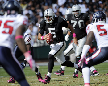 OAKLAND, CA - OCTOBER 3:  Quarterback Bruce Gradkowski #5 of the Oakland Raiders scrambles with the ball for a first down against the Houston Texans during an NFL football game October 3, 2010 at The Oakland-Alameda County Coliseum in Oakland, California.