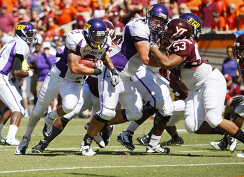 BLACKSBURG, VA - SEPTEMBER 18:  Running back Giavanni Ruffin #1 of the East Carolina Pirates runs with the ball for a touchdown past defensive tackle Dwight Tucker #53 of the Virginia Tech Hokies at Lane Stadium on September 18, 2010 in Blacksburg, Virgin