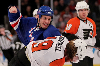 NEW YORK - APRIL 09:  Dan Girardi #5 of the New York Rangers fights with Scott Hartnell #19 of the Philadelphia Flyers during their game on April 9, 2010 at Madison Square Garden in New York City.  (Photo by Chris McGrath/Getty Images)