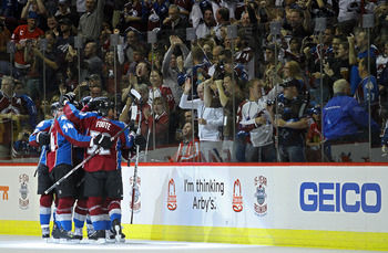 DENVER, CO - OCTOBER 7:  Colorado Avalanche players celebrate a goal by teammate Matt Duchene against the Chicago Blackhawks during both team's season openers at the Pepsi Center on October 7, 2010 in Denver, Colorado. (Photo by Marc Piscotty/Getty Images