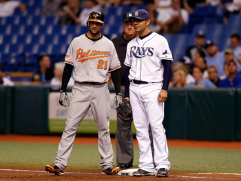ST. PETERSBURG - SEPTEMBER 27:  Nick Markakis #21 of the Baltimore Orioles talks with first baseman Carlos Pena #23 of the Tampa Bay Rays during the first inning at Tropicana Field on September 27, 2010 in St. Petersburg, Florida.  (Photo by J. Meric/Gett