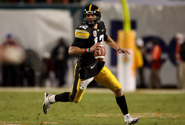 MIAMI GARDENS, FL - JANUARY 05:  Ricky Stanzi #12 of the Iowa Hawkeyes rolls out to pass against the Georgia Tech Yellow Jackets during the FedEx Orange Bowl at Land Shark Stadium on January 5, 2010 in Miami Gardens, Florida.  (Photo by Marc Serota/Getty