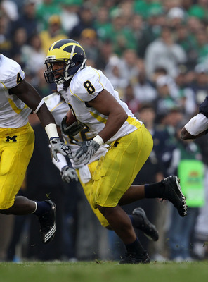 SOUTH BEND, IN - SEPTEMBER 11: Jonas Mouton #8 of the Michigan Wolverines runs after intercepting a pass against the Notre Dame Fighting Irish at Notre Dame Stadium on September 11, 2010 in South Bend, Indiana. (Photo by Jonathan Daniel/Getty Images)