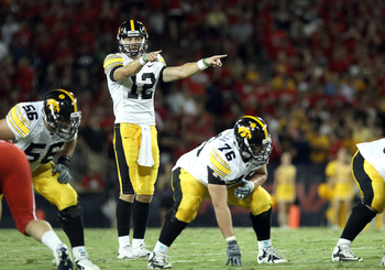 TUCSON, AZ - SEPTEMBER 18:  Quarterback Ricky Stanzi #12 of the Iowa Hawkeyes in action during the college football game against the Arizona Wildcats at Arizona Stadium on September 18, 2010 in Tucson, Arizona.  The Wildcats defeated the Hawkeyes 34-27.