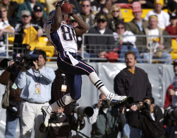 27 Jan 2002:  David Patten #86 of the New England Patriots catches a pass in the endzone to give the Patriots a 14-3 lead during the first half of the AFC  Championship Game between the Pittsburgh Steelers and the New England Patriots at Heinz Field in Pi