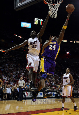 MIAMI - DECEMBER 19:  Kobe Bryant #24 of the Los Angeles Lakers scores over Joel Anthony #50 of the Miami Heat at American Airlines Arena on December 19, 2008 in Miami, Florida. NOTE TO USER: User expressly acknowledges and agrees that, by downloading and