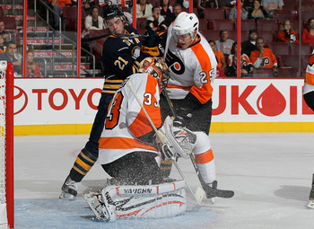 PHILADELPHIA - OCTOBER 01:  Brian Boucher #33 of the Philadelphia Flyers makes a save as teammate Matt Carle #25 defends against Drew Stafford #21 of the Buffalo Sabres on October 1, 2010 at Wells Fargo Center in Philadelphia, Pennsylvania.  (Photo by Jim