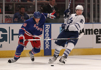 NEW YORK - APRIL 07: Phil Kessel #81 of the Toronto Maple Leafs is knocked off balance by Marc Staal #18 of the New York Rangers at Madison Square Garden on April 7, 2010 in New York City.  (Photo by Bruce Bennett/Getty Images)