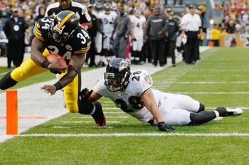 PITTSBURGH - OCTOBER 03:  Rashard Mendenhall #34 of the Pittsburgh Steelers dives in for a touchdown past Tom Zibkowski #28 of the Baltimore Ravens during the game on October 3, 2010 at Heinz Field in Pittsburgh, Pennsylvania.  (Photo by Jared Wickerham/G