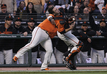 SAN FRANCISCO - OCTOBER 08:  Buster Posey #28 of the San Francisco Giants collides with Pablo Sandoval #48 trying to field a foul ball during the first inning of the National League Division Series with the Atlanta Braves at AT&T Park on October 8, 2010 i