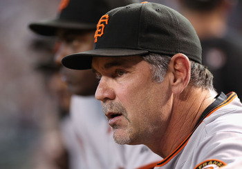 PHOENIX - SEPTEMBER 06:  Manager Bruce Bochy of the San Francisco Giants watches from dugout during the Major League Baseball game against the Arizona Diamondbacks at Chase Field on September 6, 2010 in Phoenix, Arizona.  The Giants defeated the Diamondba