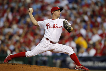 PHILADELPHIA - OCTOBER 08:  Roy Oswalt #44 of the Philadelphia Phillies pitches in Game 2 of the NLDS against the Cincinnati Reds at Citizens Bank Park on October 8, 2010 in Philadelphia, Pennsylvania.  (Photo by Jeff Zelevansky/Getty Images)