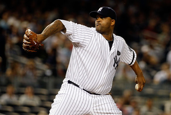 NEW YORK - SEPTEMBER 23:  CC Sabathia #52 of the New York Yankees delivers a pitch in the first-inning against the Tampa Bay Rays on September 23, 2010 at Yankee Stadium in the Bronx borough of New York City.  (Photo by Mike Stobe/Getty Images)