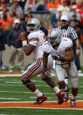 CHAMPAIGN, IL - OCTOBER 02: Terrelle Pryor #2 of the Ohio State Buckeyes looks for a receiver as teammate Dan Herron #1 runs a route against the Illinois Fighting Illini at Memorial Stadium on October 2, 2010 in Champaign, Illinois. Ohio State defeated Il