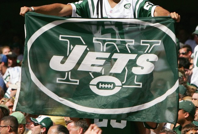 EAST RUTHERFORD, NJ - SEPTEMBER 23: A fan of the New York Jets holds up a Jets flag during the game against the Miami Dolphins on September 23, 2007 at Giants Stadium in East Rutherford, New Jersey. The Jets defeated the Dolphins 31-28. (Photo by Al Bello
