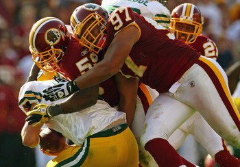 LANDOVER, MD - OCTOBER 10:  Linebackers London Fletcher #59 and Lorenzo Alexander #97 of the Washington Redskins sack quarterback Aaron Rodgers #12 of the Green Bay Packers in the fourth quarter against at FedExField on October 10, 2010 in Landover, Maryl