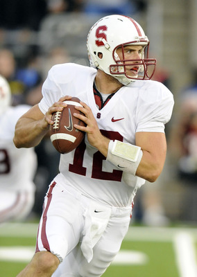 EUGENE, OR - OCTOBER 2: Quarterback Andrew Luck #12 of the Stanford Cardinal rolls out to pass the ball in the third quarter of the game against the Oregon Ducks at Autzen Stadium on October 2, 2010 in Eugene, Oregon. Oregon won the game 52-31. (Photo by