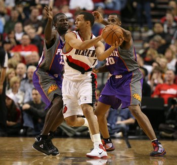 PORTLAND, OR - APRIL 29:  Brandon Roy #7 of the Portland Trail Blazers in action against Jason Richardson #23 and Jarron Collins #20 of the Phoenix Suns during Game Six of the Western Conference Quarterfinals of the NBA Playoffs on April 29, 2010 at the R