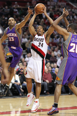 PORTLAND, OR - APRIL 29:  Andre Miller #24 of the Portland Trail Blazers rebounds against Grant Hill #33 and Jarron Collins #20 of the Phoenix Suns during Game Six of the Western Conference Quarterfinals of the NBA Playoffs on April 29, 2010 at the Rose G