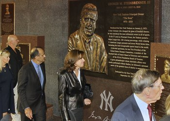 NEW YORK - SEPTEMBER 20:  Former manager of the New York Yankees Joe Torre (3rd L) walks past the monument of late owner George Steinbrenner with his wife Ali prior to the game against the Tampa Bay Rays on September 20, 2010 at Yankee Stadium in the Bron