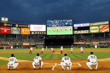 NEW YORK - SEPTEMBER 22: Members of the world championship winning China Youth Baseball League team throw out the first pitch prior to the start of the game between the New York Yankees and the Tampa Bay Rays during their game on September 22, 2010 at Yan