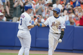 FLUSHING, NY - JULY 14: Vance Wilson #3 and Rey Ordonez #10 of the New York Mets shake hands after being driven home on a double by Robbie Alomar against the Philadelphia Phillies on July 14, 2002 at Shea Stadium in Flushing, New York.  The Mets beat the