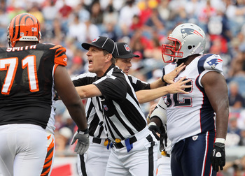 FOXBORO, MA - SEPTEMBER 12:  The officiasl break up a scuffle between Andre Smith #71 of the Cincinnati Bengals and Gerard Warren #92 of the New England Patriots during the NFL season opener on September 12, 2010 at Gillette Stadium in Foxboro, Massachuse