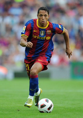 BARCELONA, SPAIN - SEPTEMBER 11:  Adriano of Barcelona runs with the ball during the La Liga match between Barcelona and Hercules at the Camp Nou stadium on September 11, 2010 in Barcelona, Spain. Barcelona lost the match 2-0.  (Photo by Jasper Juinen/Get