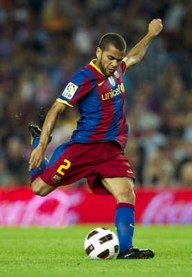 BARCELONA, SPAIN - SEPTEMBER 22:  Daniel Alves of Barcelona in action during the La Liga match between Barcelona and Sporting de Gijon at Nou Camp on September 22, 2010 in Barcelona, Spain. Barcelona won 1.0.  (Photo by Manuel Queimadelos Alonso/Getty Ima