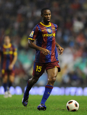 BILBAO, SPAIN - SEPTEMBER 25:  Seydou Keita of Barcelona runs with the ball during the La Liga match between Athletic Bilbao and Barcelona at the San Mames Stadium on September 25, 2010 in Bilbao, Spain. Barcelona won the match 3-1.  (Photo by Jasper Juin