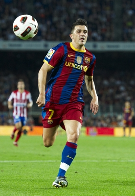 BARCELONA, SPAIN - SEPTEMBER 22:  David Villa of Barcelona in action during the La Liga match between Barcelona and Sporting de Gijon at Nou Camp on September 22, 2010 in Barcelona, Spain. Barcelona won 1-0.  (Photo by Manuel Queimadelos Alonso/Getty Imag