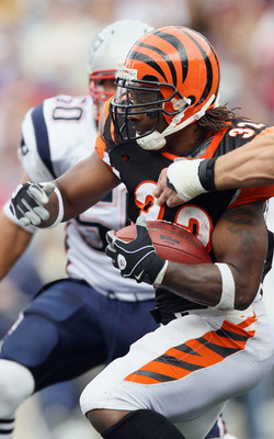 FOXBORO, MA - SEPTEMBER 12: Cedric Benson #32 of the Cincinnati Bengals carries the ball against the New England Patriots during the NFL season opener on September 12, 2010 at Gillette Stadium in Foxboro, Massachusetts.  (Photo by Elsa/Getty Images)