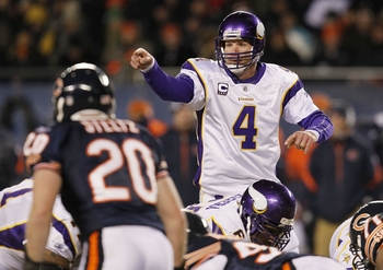 CHICAGO - DECEMBER 28:  Brett Favre #4 of the Minnesota Vikings points from under center in the third quarter against the Chicago Bears at Soldier Field on December 28, 2009 in Chicago, Illinois. (Photo by Jonathan Daniel/Getty Images)