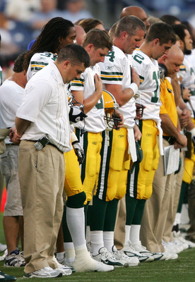 NASHVILLE, TN - SEPTEMBER 1:  Brett Favre #4 of the Green Bay Packers and the rest of his teammates observe a moment of silence to honor the victims of hurricane Katrina before the first half on September 1, 2005 at The Coliseum in Nashville, Tennessee.