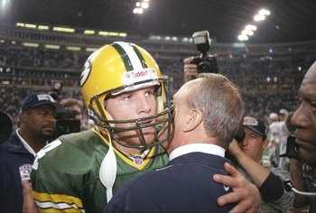 18 Nov 1996:  Quarterback Brett Favre of the Green Bay Packers and Dallas Cowboys owner Jerry Jones confer after a game at Texas Stadium in Irving, Texas.  The Cowboys won the game, 21-6. Mandatory Credit: Craig Jones  /Allsport