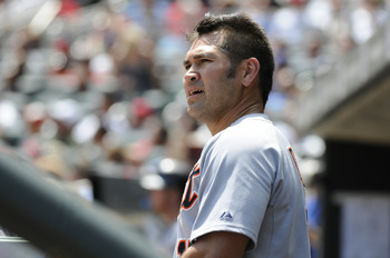 MINNEAPOLIS, MN - JUNE 30: Johnny Damon #18 of the Detroit Tigers looks on in the dugout in the sixth inning against the Minnesota Twins during their game on June 30, 2010 at Target Field in Minneapolis, Minnesota. Twins won 5-1. (Photo by Hannah Foslien