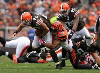CLEVELAND - OCTOBER 03:  Running back Peyton Hillis #40 of the Cleveland Browns is hit by cornerback Leon Hall #29 of the Cincinnati Bengals at Cleveland Browns Stadium on October 3, 2010 in Cleveland, Ohio.  (Photo by Matt Sullivan/Getty Images)