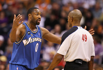 PHOENIX - DECEMBER 19:  Gilbert Arenas #0 of the Washington Wizards reacts to a call from referee Tom Washington during the NBA game against the Phoenix Suns at US Airways Center on December 19, 2009 in Phoenix, Arizona. NOTE TO USER: User expressly ackno