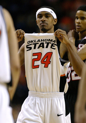 KANSAS CITY, MO - MARCH 13:  JamesOn Curry #24 of the Oklahoma State Cowboys shows off his jersey as he celebrates after the Cowboys won the Phillips 66 Big 12 Men's Basketball Tournament against the Texas Tech Red Raiders on March 13, 2005 at Kemper Aren