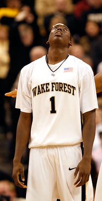 WINSTON-SALEM, NC - JANUARY 21:  Al-Farouq Aminu #1 of the Wake Forest Demon Deacons reacts as he walks down the court with teammate James Johnson #23 to a 78-71 loss to the Virginia Tech Hokies at Lawrence Joel Coliseum on January 21, 2009 in Winston-Sal