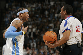 DENVER - APRIL 30:  Allen Iverson #3 of the Denver Nuggets questions referee Eddie F. Rush #32 after getting called for a foul against Tim Duncan of the San Antonio Spurs in the fourth quarter of Game Four of the Western Conference Quarterfinals during th