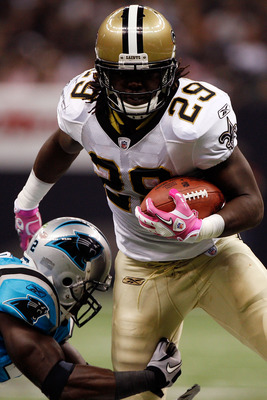 NEW ORLEANS - OCTOBER 03:  Chris Ivory #29 of the New Orleans Saints is tackled by Jon Beason #52 of the Carolina Panthers at the Louisiana Superdome on October 3, 2010 in New Orleans, Louisiana. The Saints defeated the Panthers 16-14.    (Photo by Chris