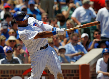 CHICAGO - JULY 03: Marlon Byrd #24 of the Chicago Cubs takes a swing against the Cincinnati Reds at Wrigley Field on July 3, 2010 in Chicago, Illinois. The Cubs defeated the Reds 3-1. (Photo by Jonathan Daniel/Getty Images)