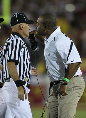 LOS ANGELES, CA - SEPTEMBER 11:  Head coach Mike London of the Virginia Cavaliers complains to an official during the game against the USC Trojans at Los Angeles Memorial Coliseum on September 11, 2010 in Los Angeles, California. USC won 17-14.  (Photo by