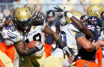 ATLANTA - OCTOBER 09:  Anthony Allen #18 of the Georgia Tech Yellow Jackets rushes through the line against the Virginia Cavaliers at Bobby Dodd Stadium on October 9, 2010 in Atlanta, Georgia.  (Photo by Kevin C. Cox/Getty Images)
