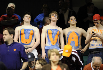 GREENSBORO, NC - MARCH 12:  Fans of the University of Virginia Cavaliers watch the game against the Duke Blue Devils in their quarterfinal game in the 2010 ACC Men's Basketball Tournament at the Greensboro Coliseum on March 12, 2010 in Greensboro, North C