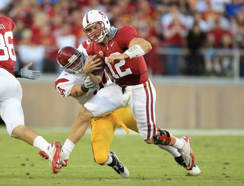 PALO ALTO, CA - OCTOBER 09:  Andrew Luck #12 of the Stanford Cardinal is tackled by Chris Galippo #54 of the USC Trojans at Stanford Stadium on October 9, 2010 in Palo Alto, California.  (Photo by Ezra Shaw/Getty Images)