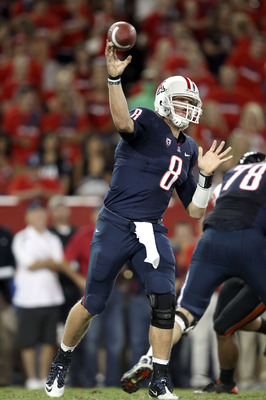TUCSON, AZ - OCTOBER 09:  Quarterback Nick Foles #8 of the Arizona Wildcats throws a pass during the college football game against the Oregon State Beavers at Arizona Stadium on October 9, 2010 in Tucson, Arizona.  (Photo by Christian Petersen/Getty Image