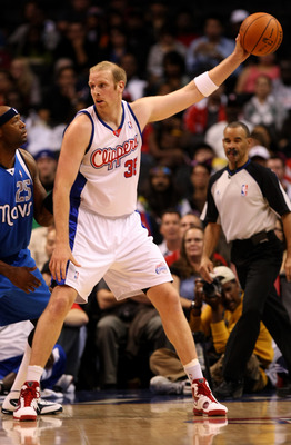 LOS ANGELES, CA - OCTOBER 31:  Chris Kaman #35 of the Los Angeles Clippers controls the ball against Erick Dampier #25 of the Dallas Mavericks on October 31, 2009 at Staples Center in Los Angeles, California. Dallas won 93-84.   NOTE TO USER: User express